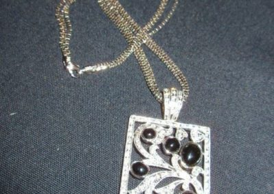14 karat gold pendant on chain with diamonds and onyx