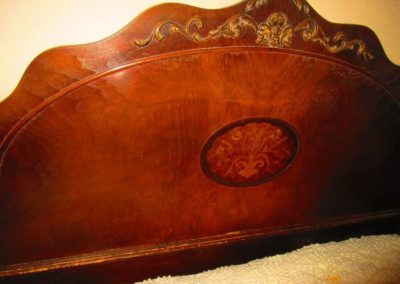 Detail of inlaid headboard on 1940s bed