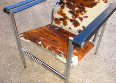 Chrome, leather and cowhide accent chair