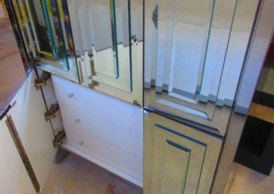 Interior of mirrored cabinet by Ello