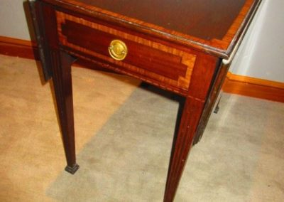 One of a pair of Pembroke tables