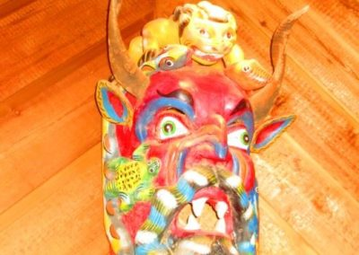 Large ethnographic hand-carved mask with horns