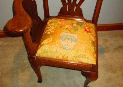 19th century corner chair wearing antique textile