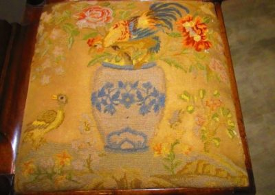 Detail of antique textile on 19th century corner chair