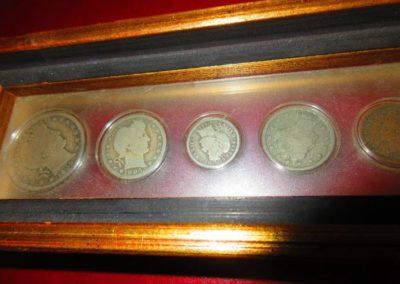 Framed antique silver coins