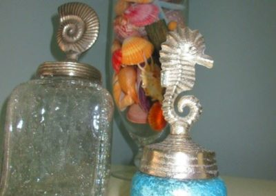Decorative seaside motif lidded jars