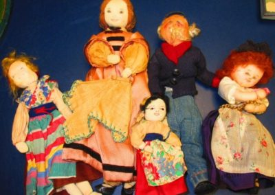 Group of antique folk art dolls