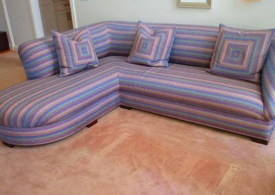 One of a pair of contemporary quilted sectional sofas
