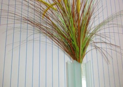 Contemporary glass vase with natural grasses