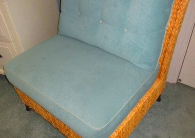 Woven chair with seafoam upholstery