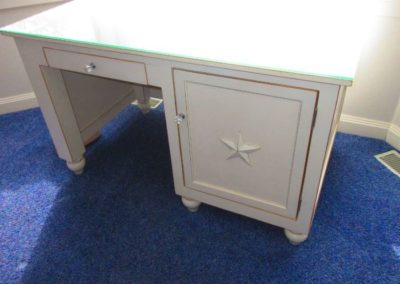 Contemporary desk with star detail on door