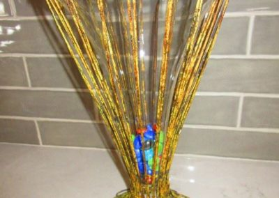 Tall iron and glass vase
