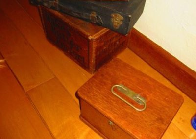 A group of boxes and antique medical equipment