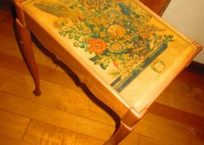 A hand constructed side table with a vintage botanical