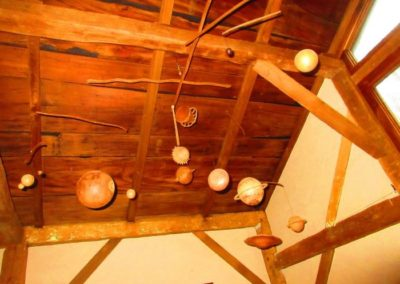 An unbelievably well-constructed and very large mobile of a solar system, all hand carved