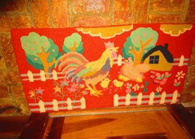 Vintage hooked rug with chicken and cock
