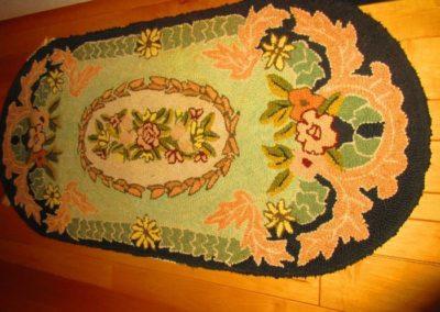 Antique floral hooked rug