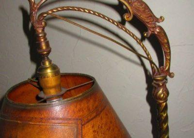 Detail of arc of antique bridge lamp