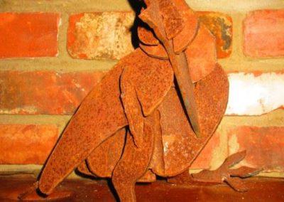Rusty iron bird puzzle, 1 of 4