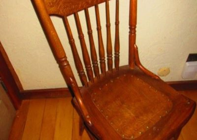 One of many oak pressed back side chairs oh, first quarter of the 20th century