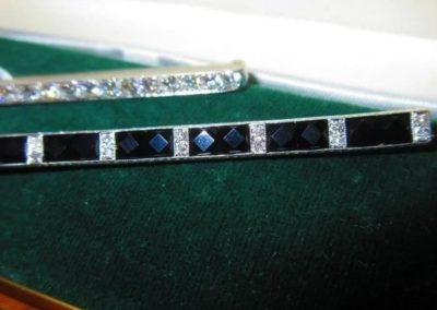 Platinum and 14kt gold diamond bar pin, total weight 3.5 dwt/ 14 kt gold and platinum onyx and diamond bar pin, total weight 3.3 dwt