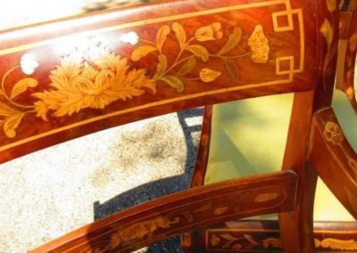 Detail a French inlaid armchair