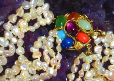 Multi-strand freshwater pearl necklace with 14kt gold and semi-precious Stone clasp