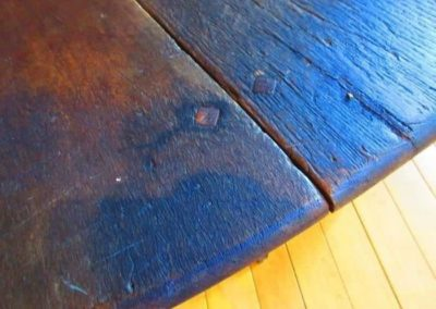 Detail of early 18th century drop leaf gates leg table