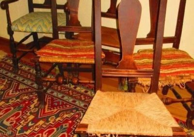 A group of four 18th century side chairs and an eighteenth-century armchair