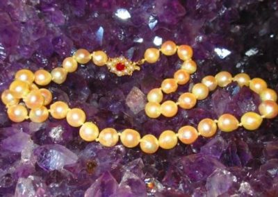 Strand of Baroque cultured pearls with 14 karat gold and ruby clasp, total weight 22.4 dwt