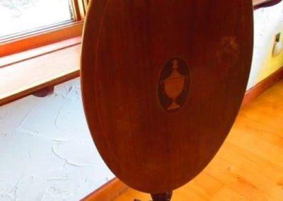 Vintage tilt top table with urn Center medallion