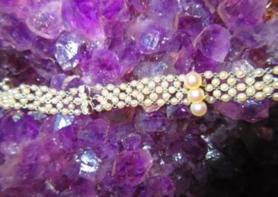 detail of Platinum and 14kt white gold, pearl, and diamond bracelet, total weight 10.1 dwt