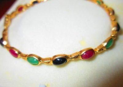 14 karat gold bracelet with multi gem tourmaline cabochons
