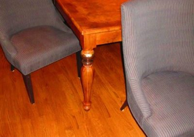 Rosewood and Burlwood veneered dining table and upholstered dining chairs