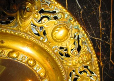 Mid 19th C. brass mirror detail
