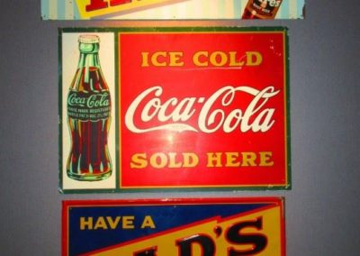 grouping of vintage advertising signs
