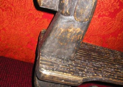 Detail of hand carved dog bench and foot rest