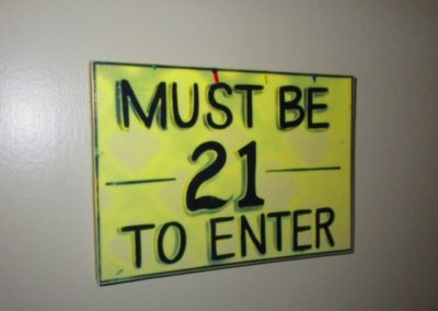 """Must be 21 to enter"" sign"