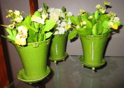 Group of Faux Flowers in Ceramic Pots